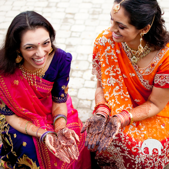 Indian Bride and sister laughing