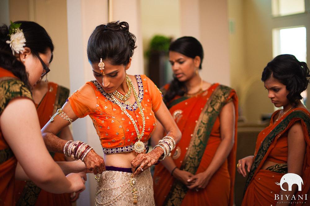 Bridesmaids Helping Bride Put On Her Indian Wedding Dress Dallas Bridal Portrait