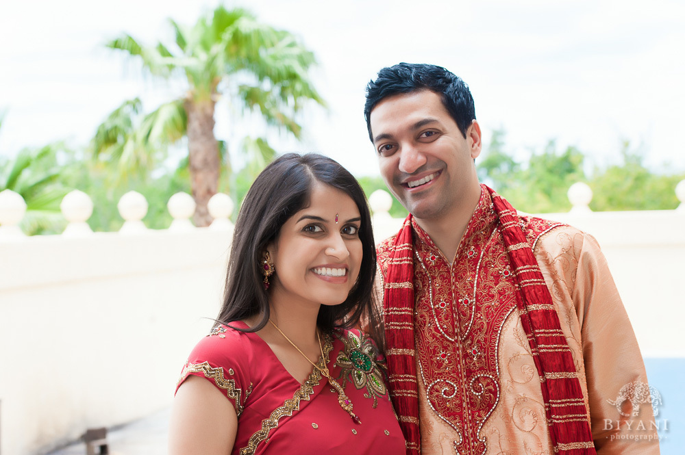 Indian Couple smiling during their Indian Engagement Photography shoot at the balcony of the Hindu Temple of Florida