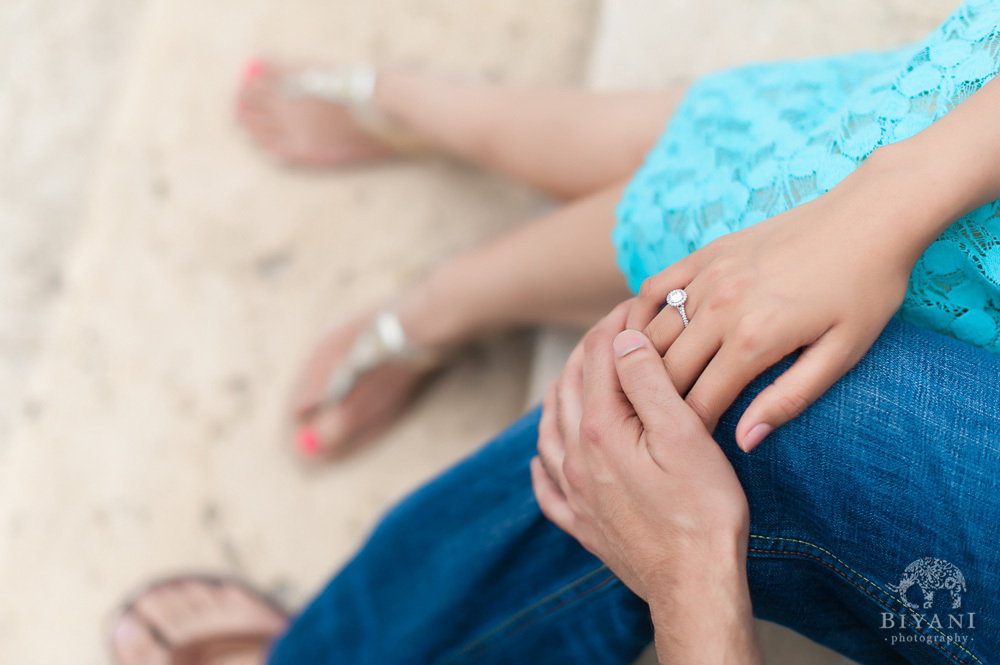 Indian Couple holding hands and showing their Engagement Rings at the Tampa Bay Beach, Florida for their Indian Engagement Photographer