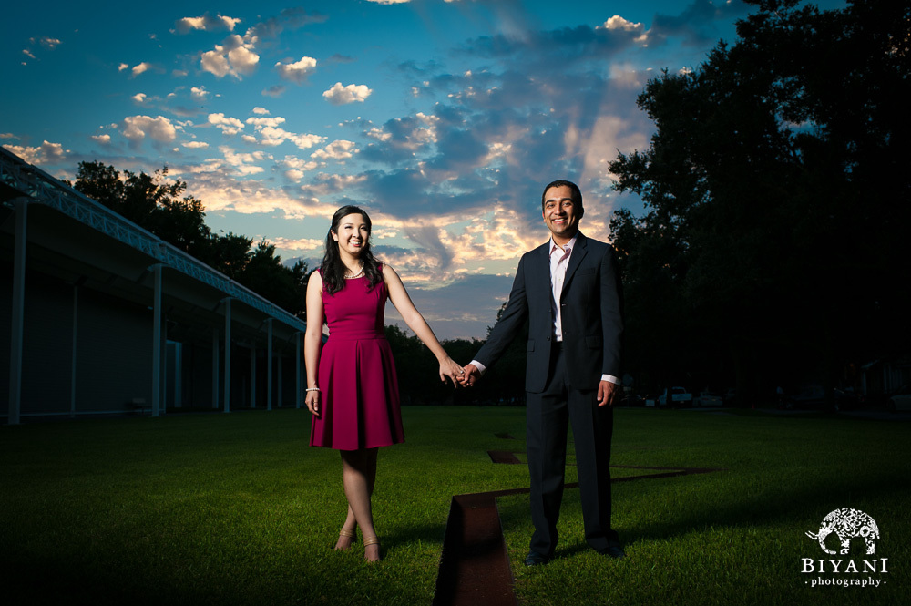 Couple holding hands outside Menil Collection Houston at sunset and posing for their engagement photos