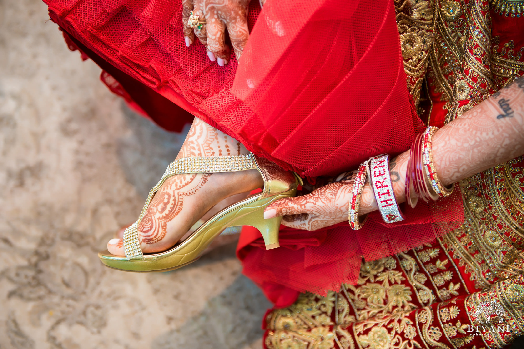 Bride puts on shoes before ceremony