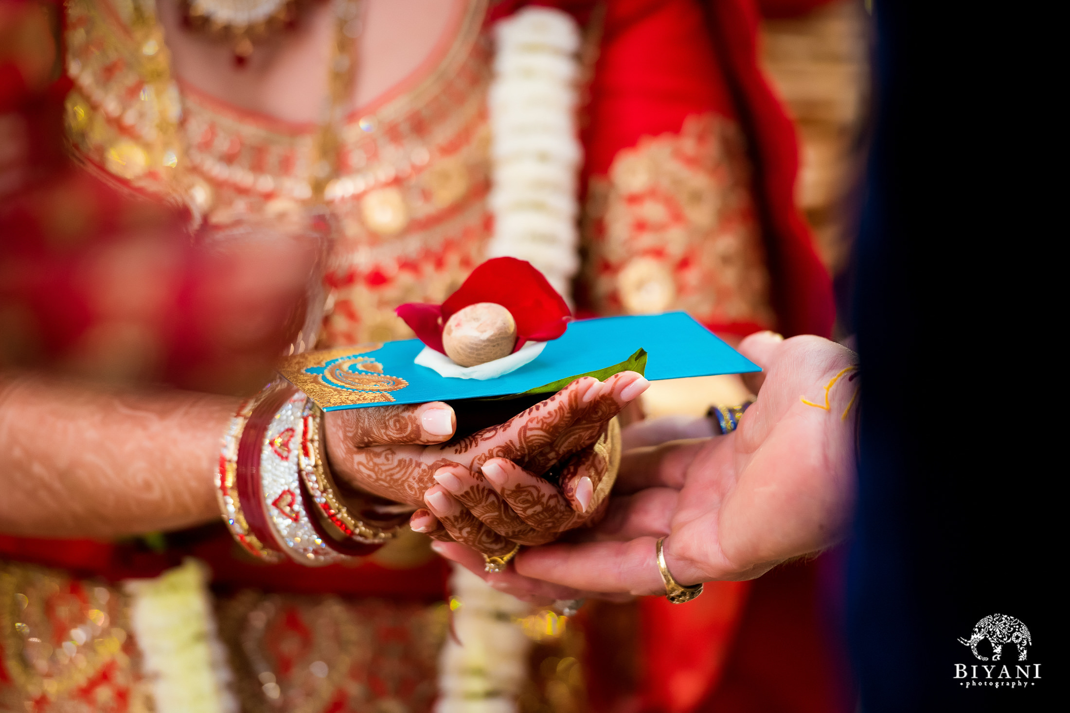 The bride offers gifts during Indian ceremony