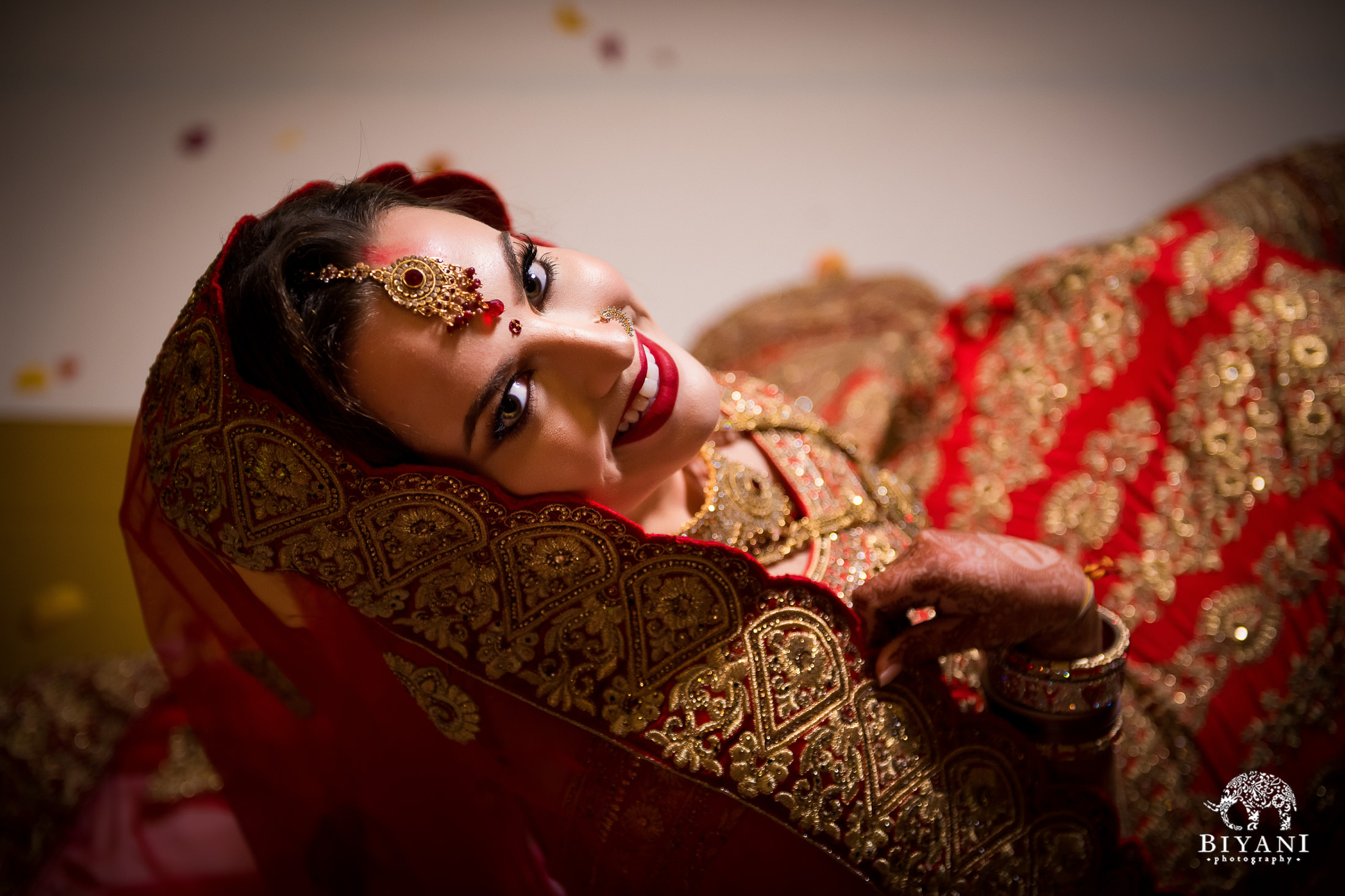 Bride poses in wedding ceremony outfit