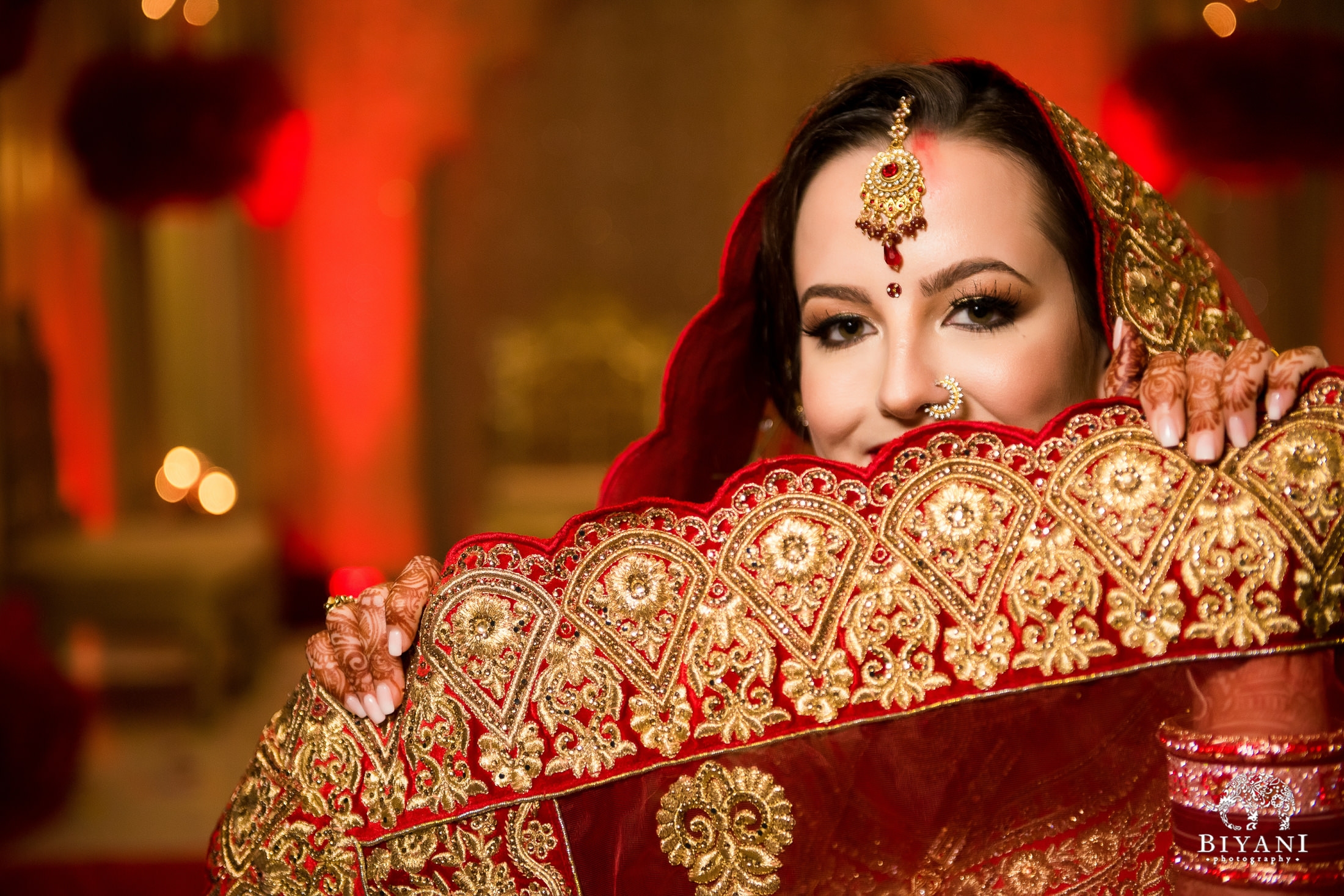 Bride poses with ceremony outfit