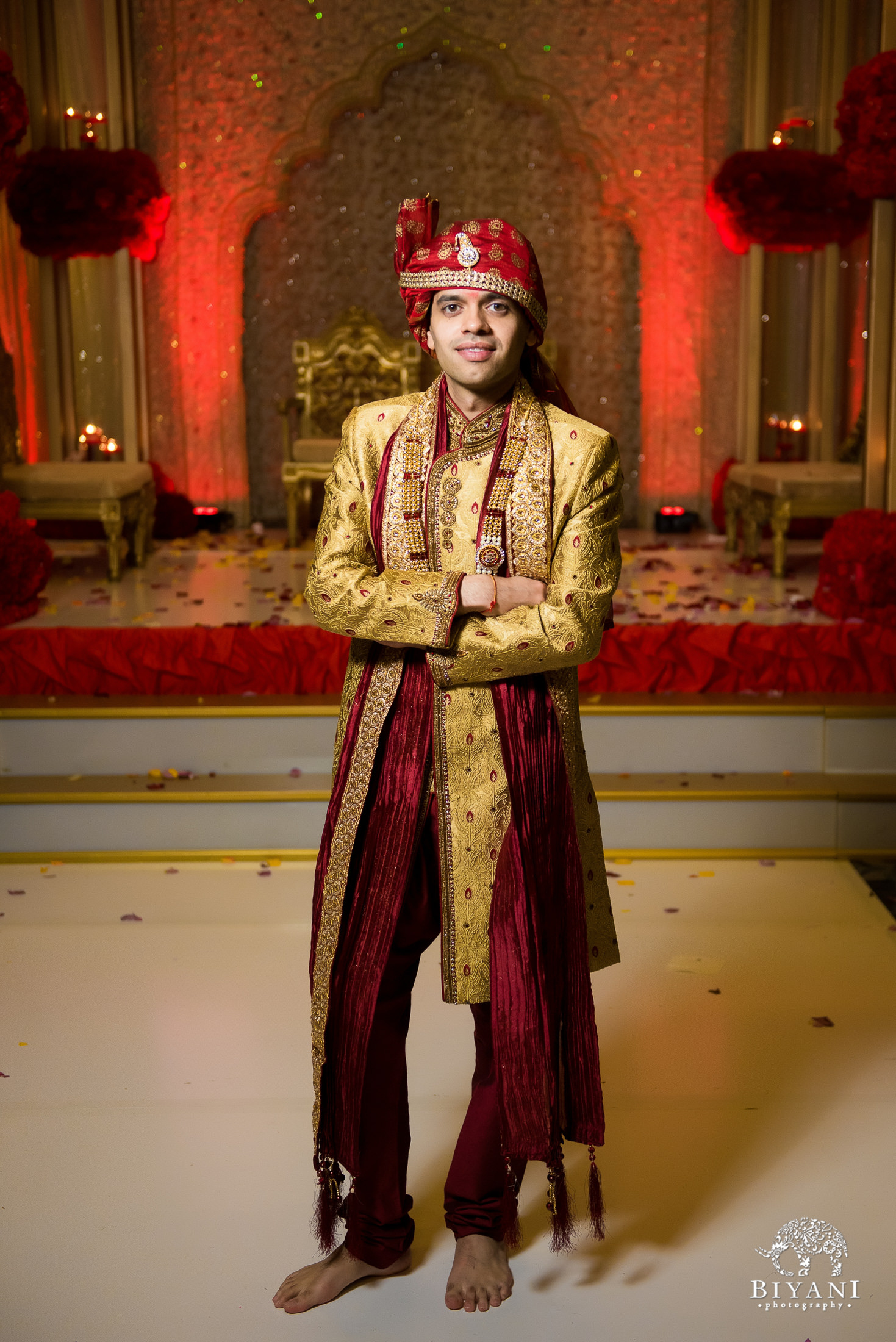 Groom poses in ceremony outfit