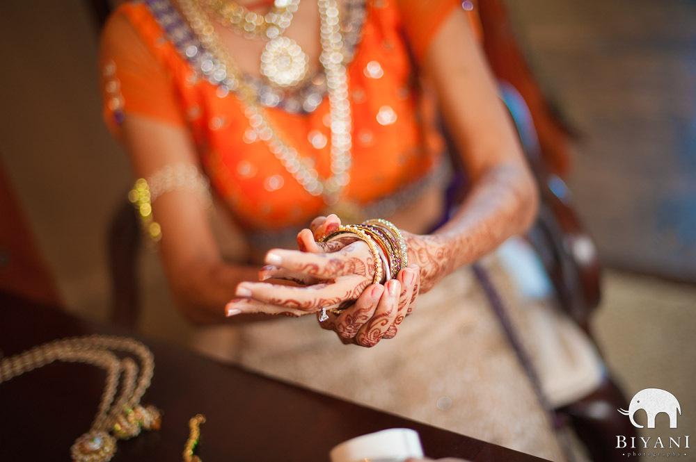 Bride putting on her bangles - chooris