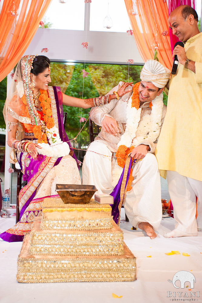 Candid photo of bride teasing groom during wedding ceremony