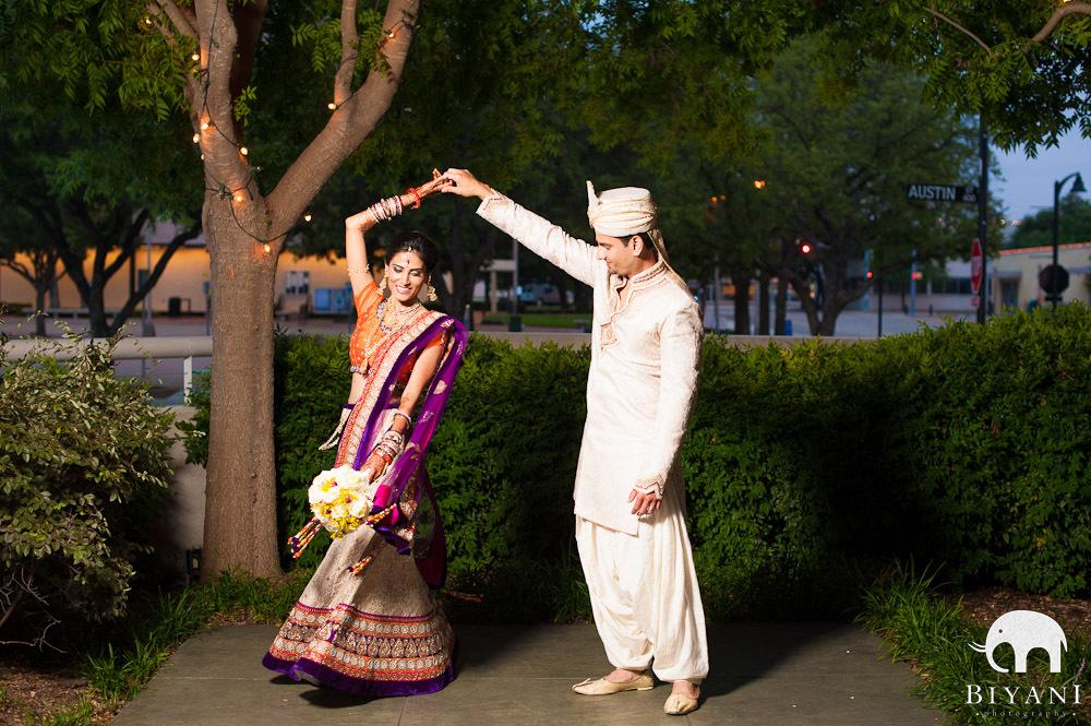 Bride and groom dancing - groom twirling the bride