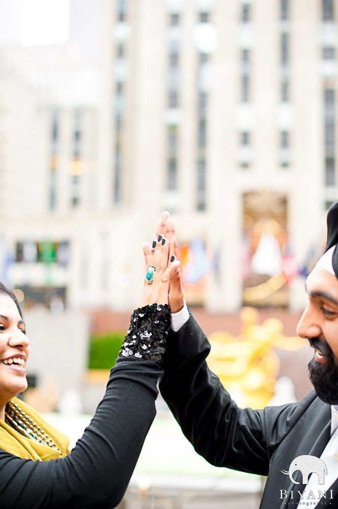 Hig Fiving couple, engagement photos in New York