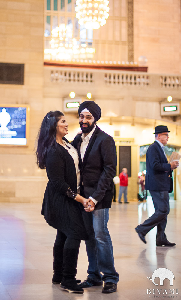 Indian Couple dancing and smiling during Engagement photos at Grand Central Terminal, New York