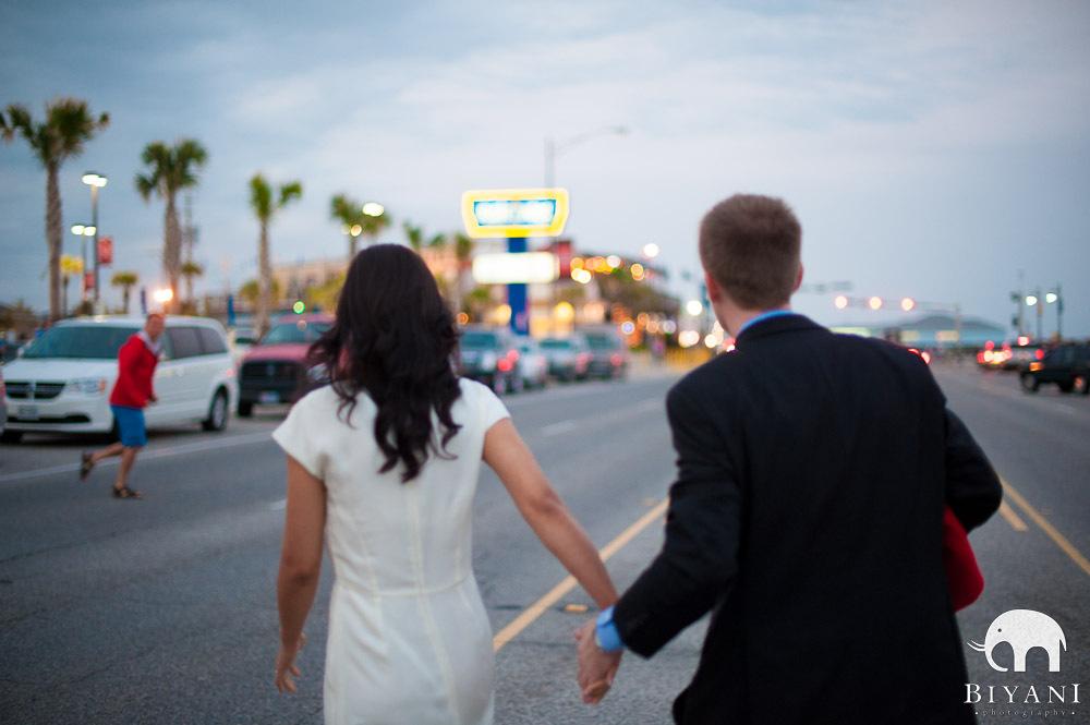Fusion Indian couple crossing the road - Galveston, Texas
