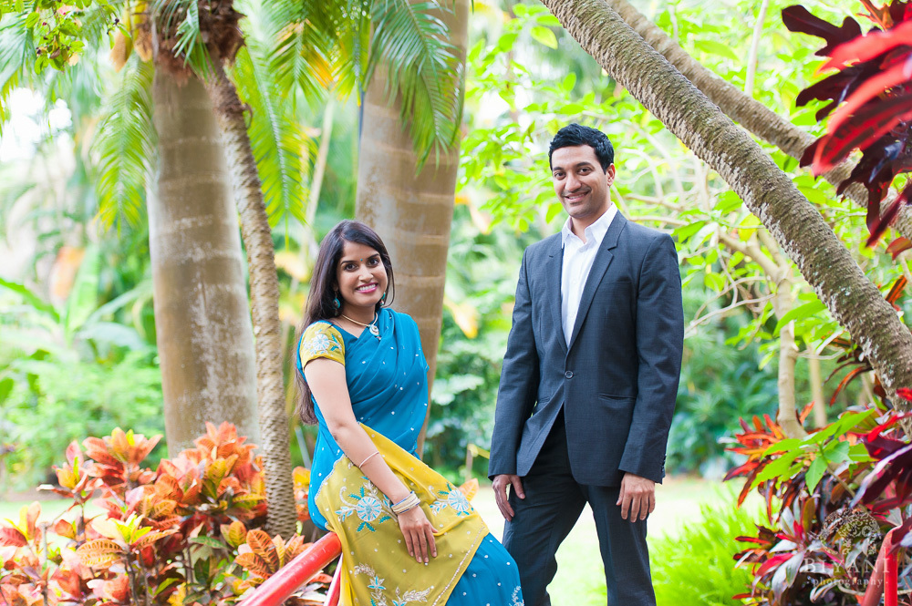 Engaged Indian couple posing for their Florida Indian Engagement Photography shoot at Sunken Gardens, St. Petersburg Florida