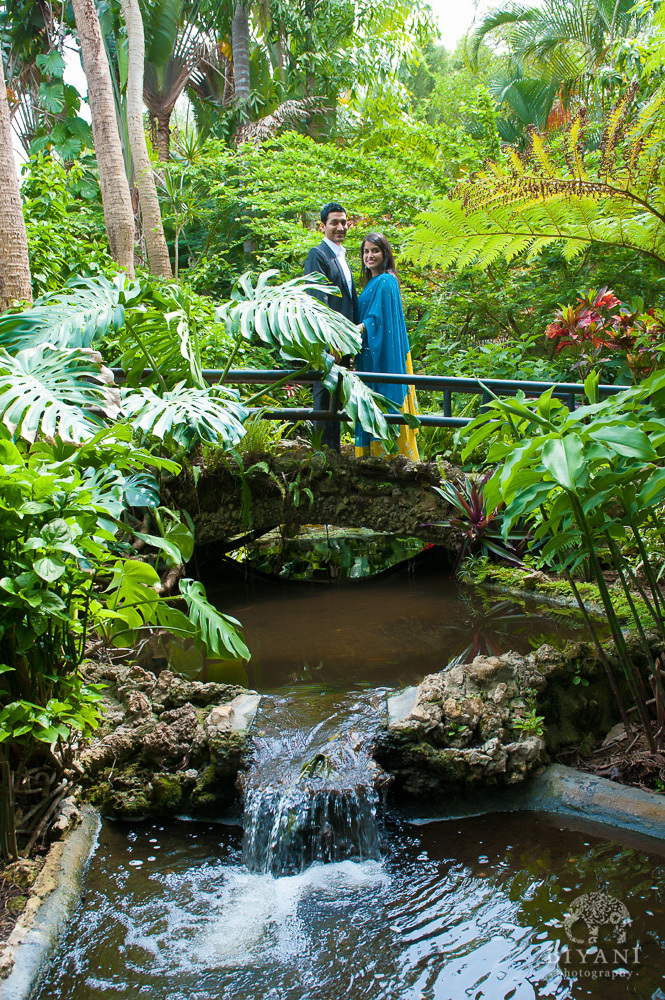Indian Engagement Photography by waterfall and bride at Sunken Gardens in St. Petersburg Florida