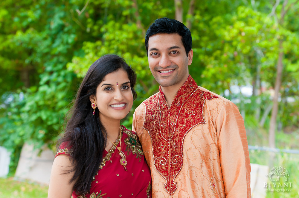 Indian Couple posing for their Engagement photos at the gardens out the Hindu Temple of Florida in Tampa, Florida during their Indian Engagement photos