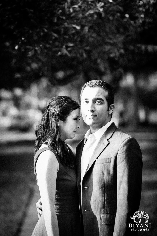Black and White photo of engagement couple at Menil Collection houston. Groom staring at the camera, Bride looking away