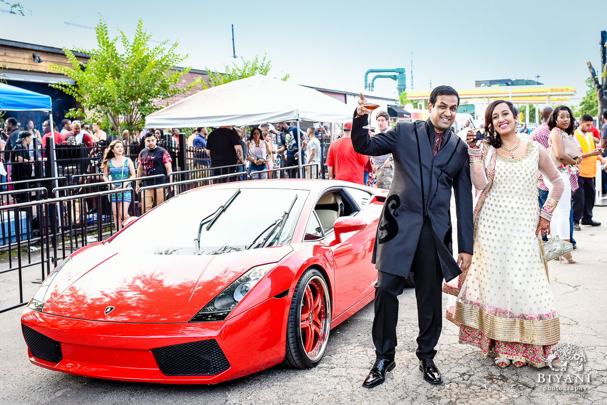 Indian Sangeet couple posing with fancy car - Lamborghini