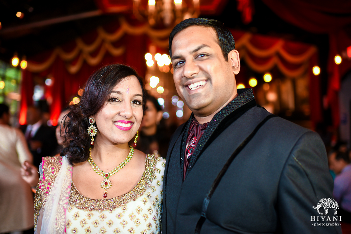 Similing Indian Couples photo with Parisian Decor