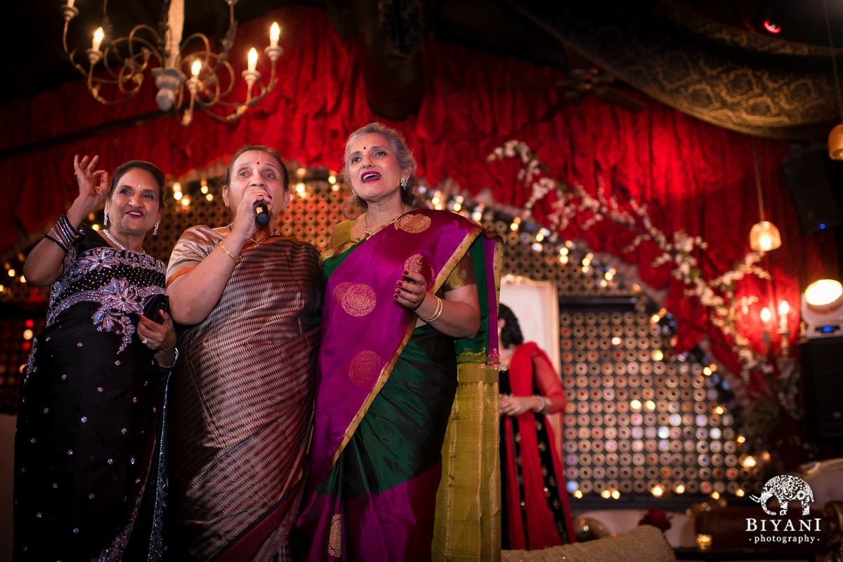 Moms singing for the couple at the Sangeet
