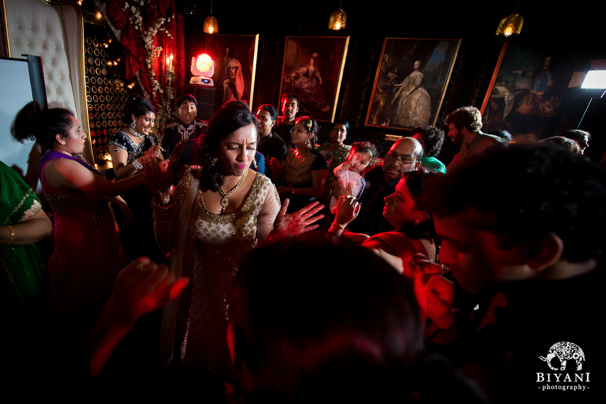 bride dancing with friends and family at sangeet