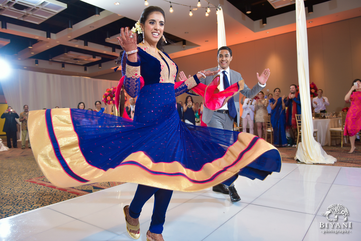Indian bride twirling dress at reception