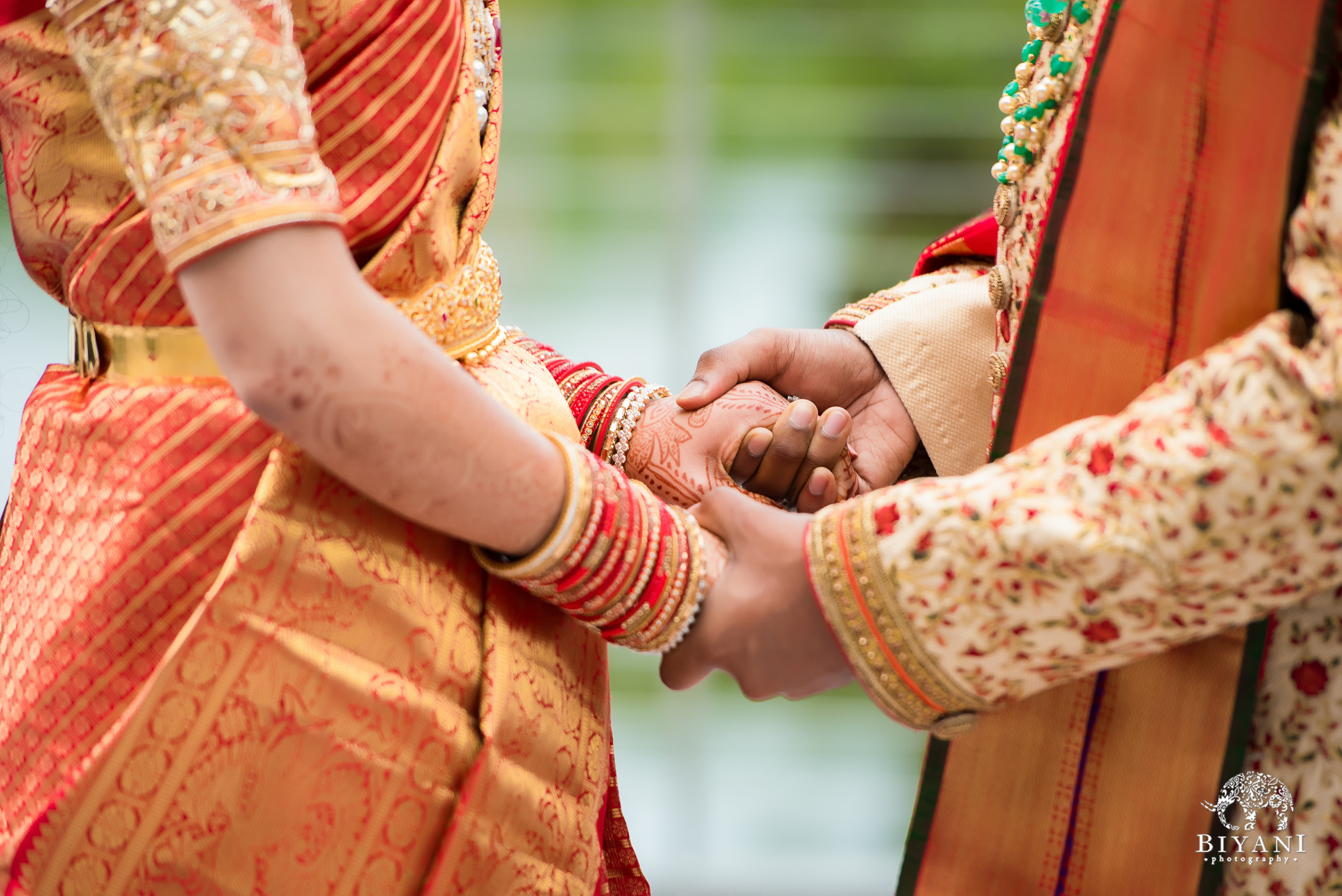 Telugu bride and groom holding hands
