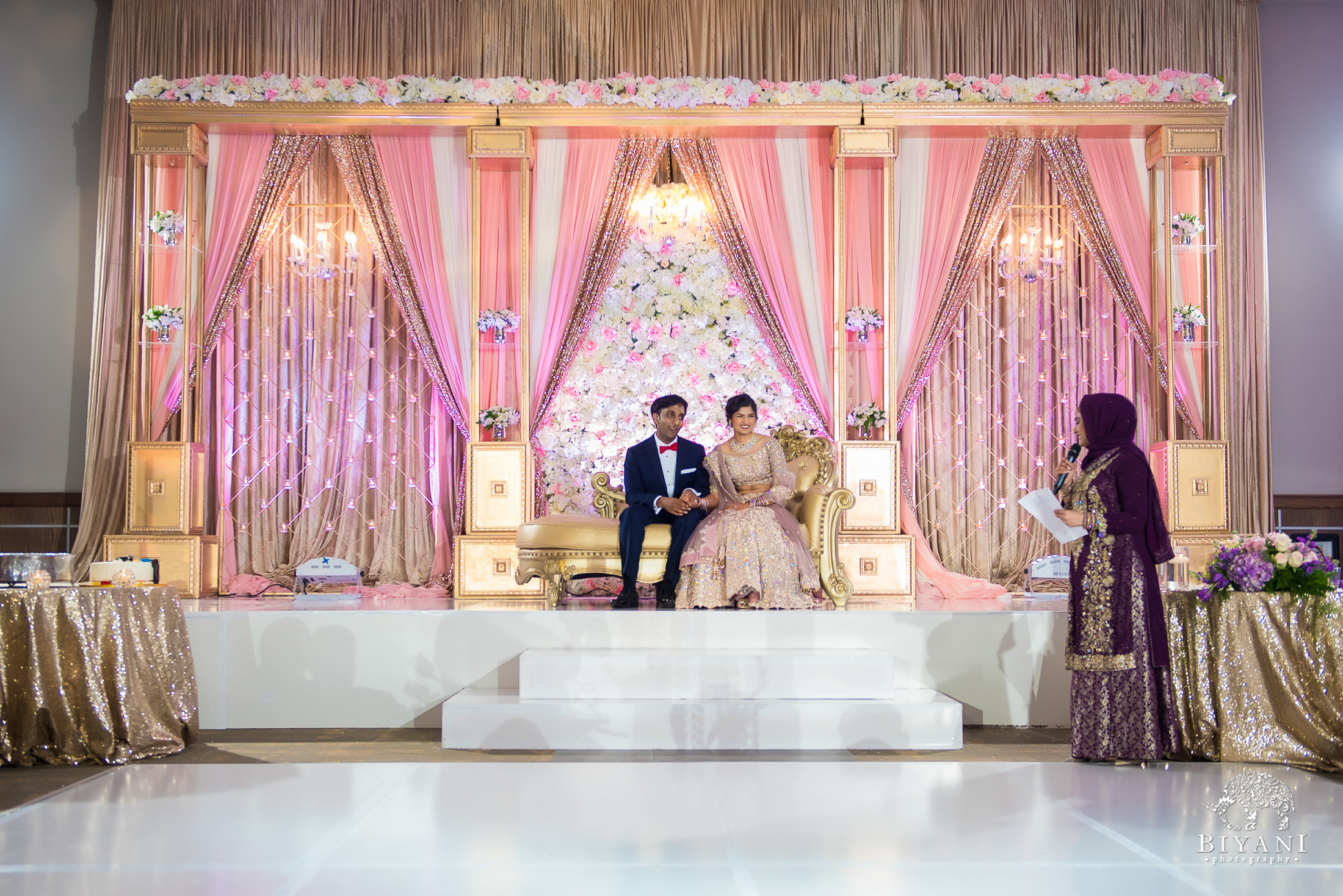 Bride and groom on reception stage
