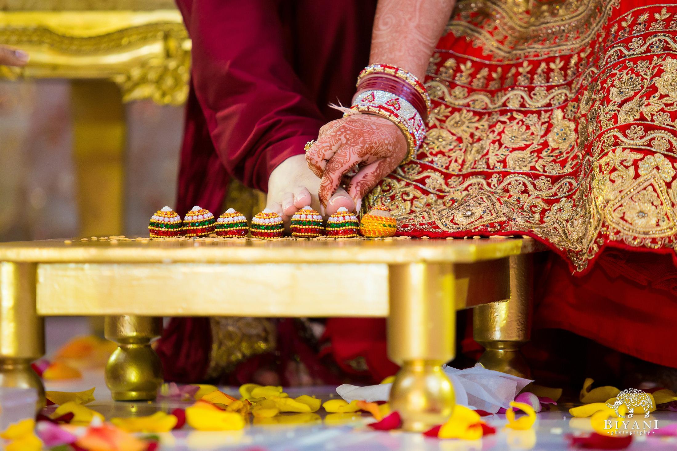 Bride performs traditional wedding ceremony activity to groom