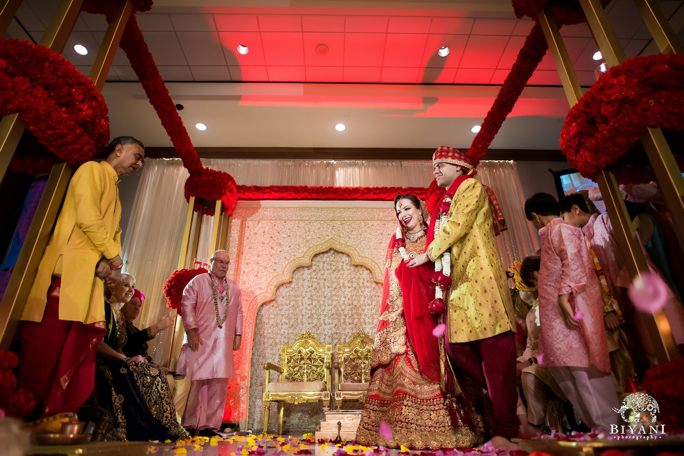 Fusion Indian American bride and groom walk around ceremony fire