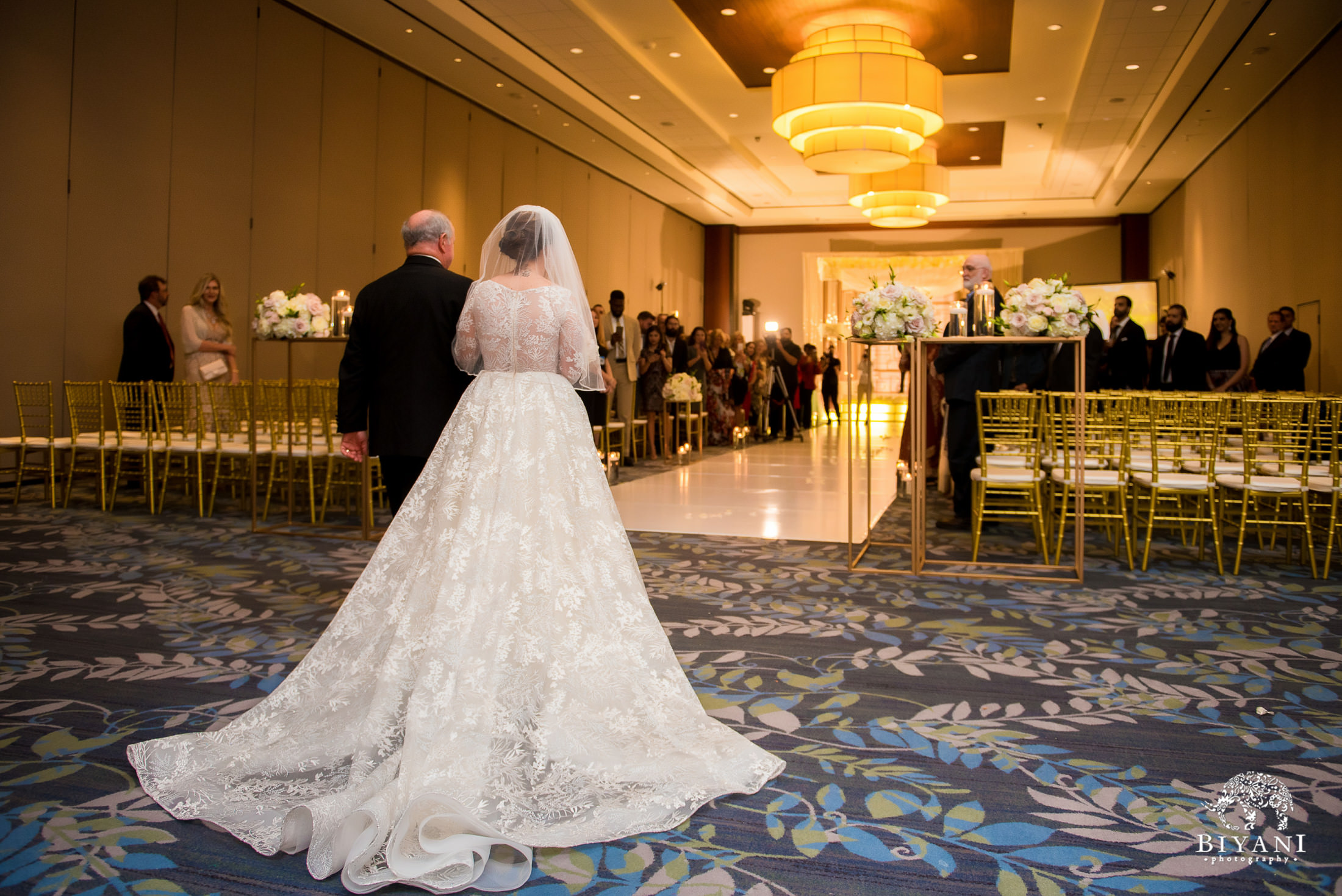 Bride escorted by her father down the aisle