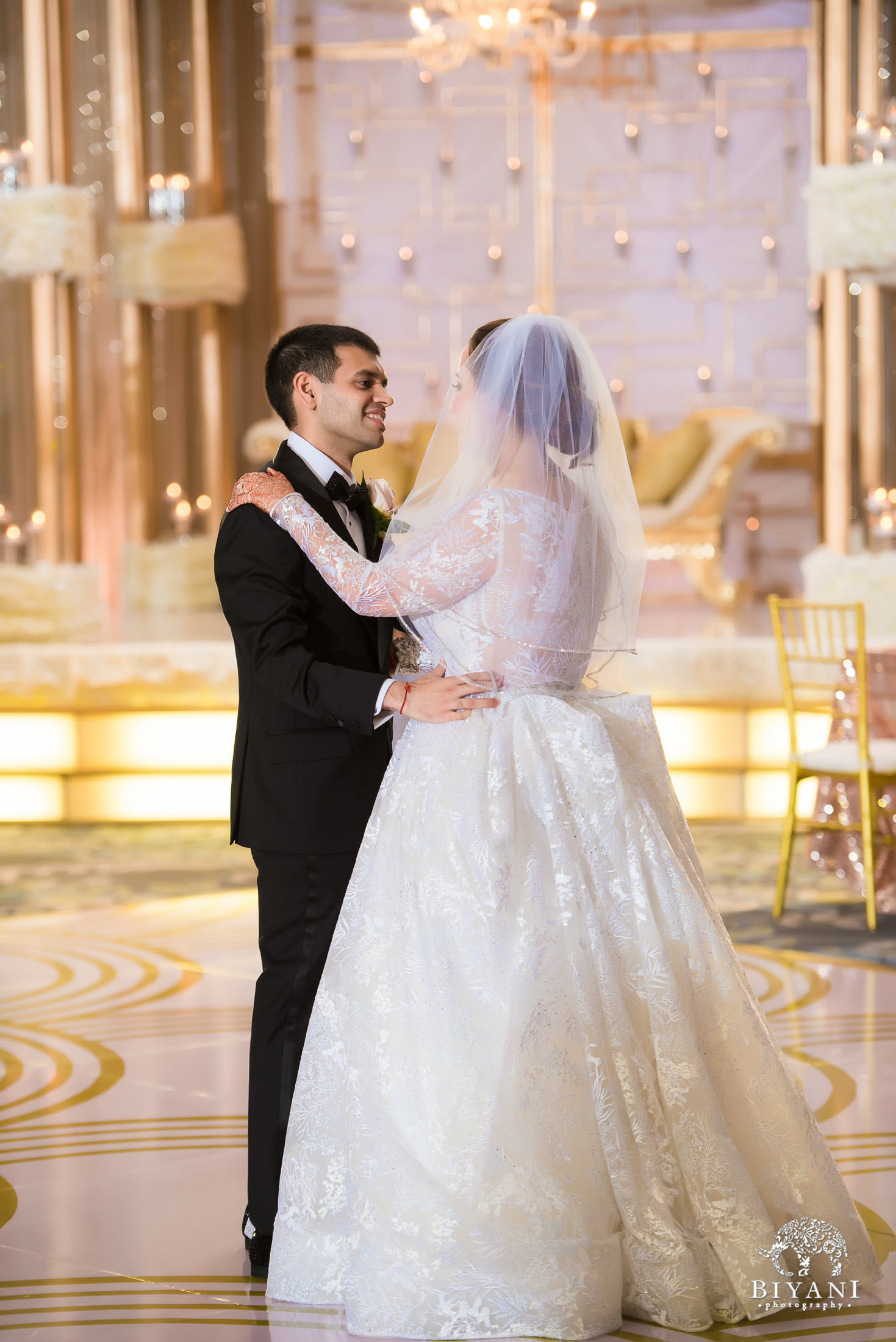 Bride and groom share their first dance at reception