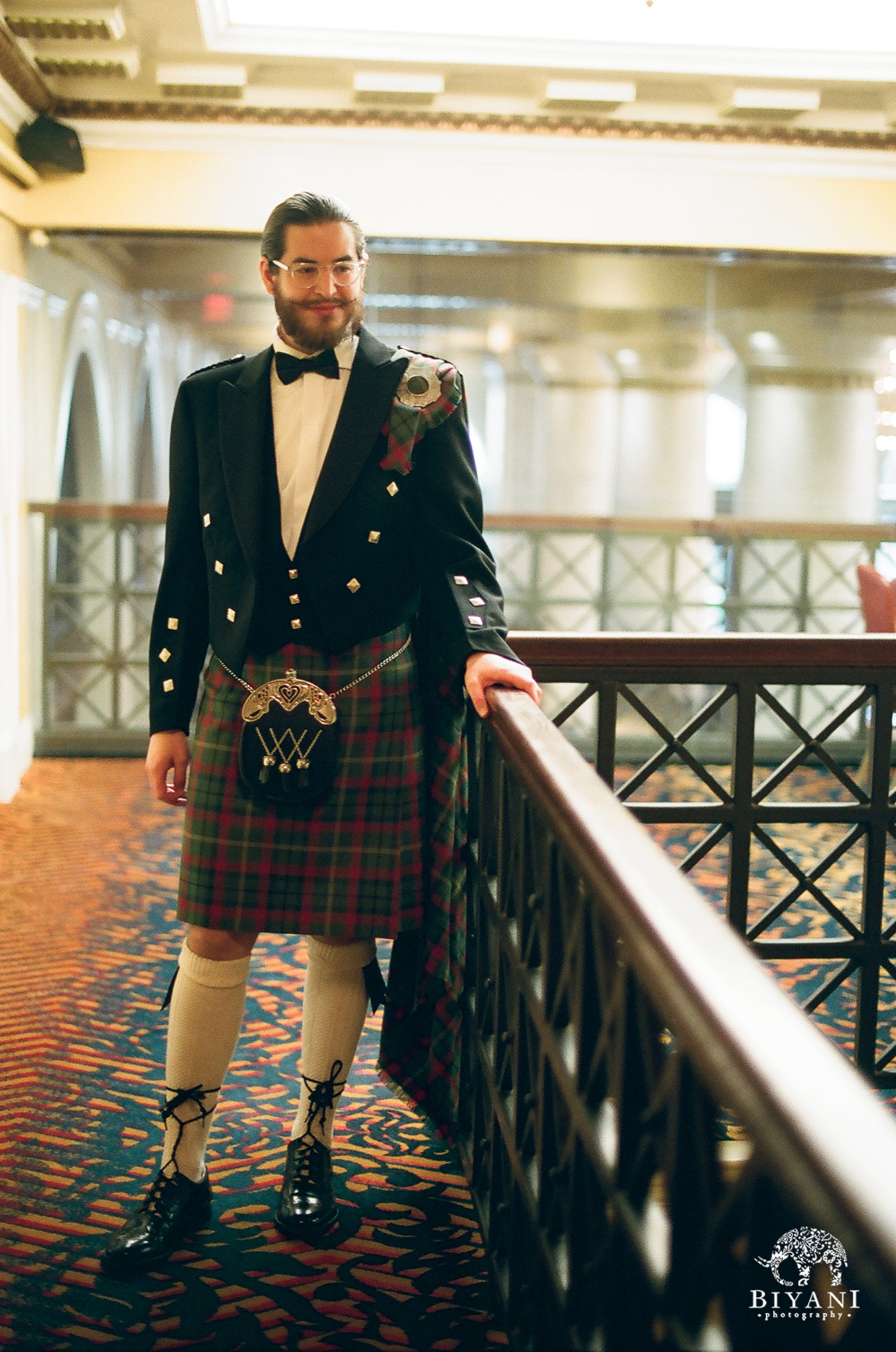 Mustachioed groom rocking a kilt for his wedding