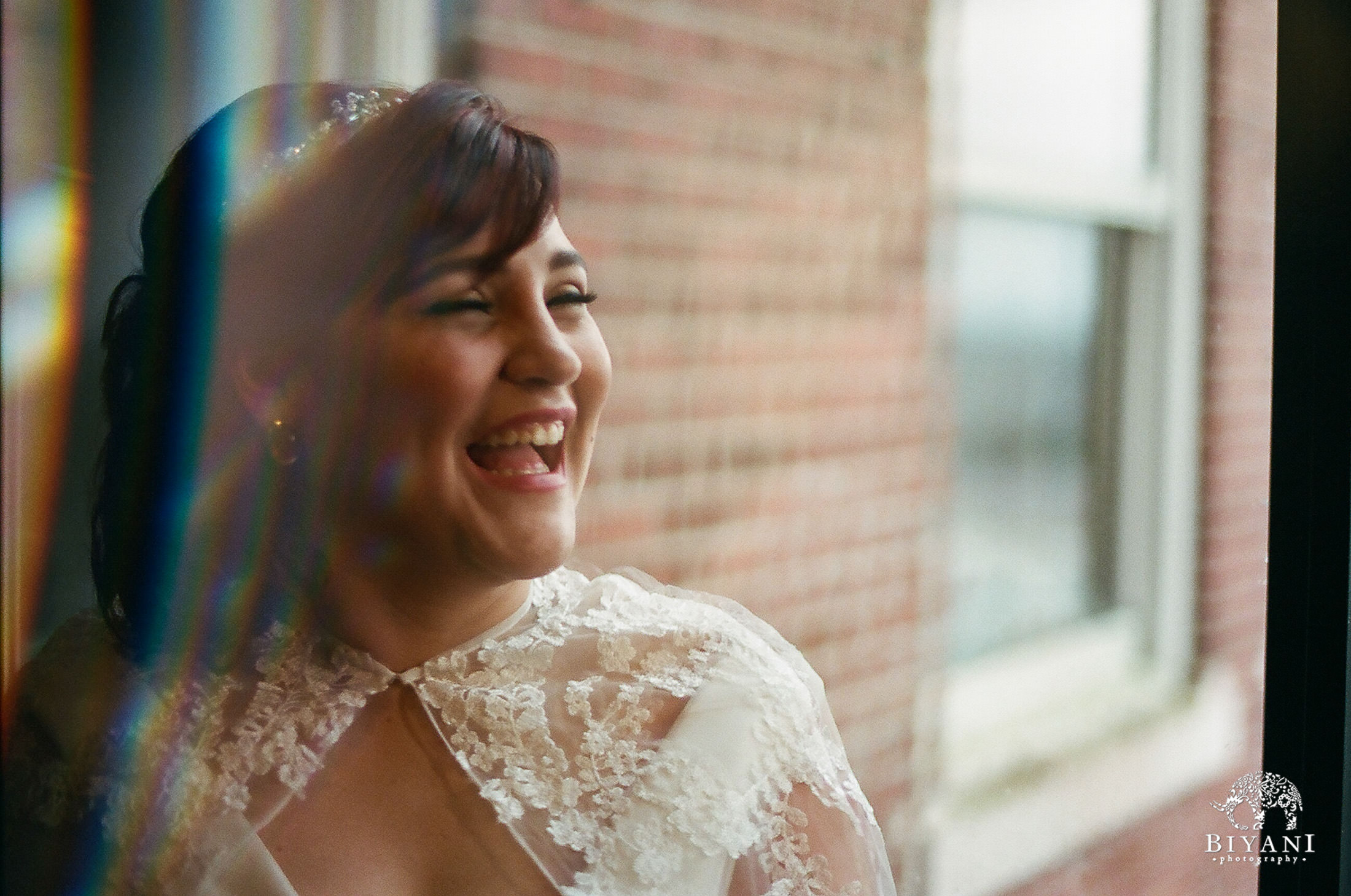 The Bride's gorgeous smile, while she awaits her groom for their First Look