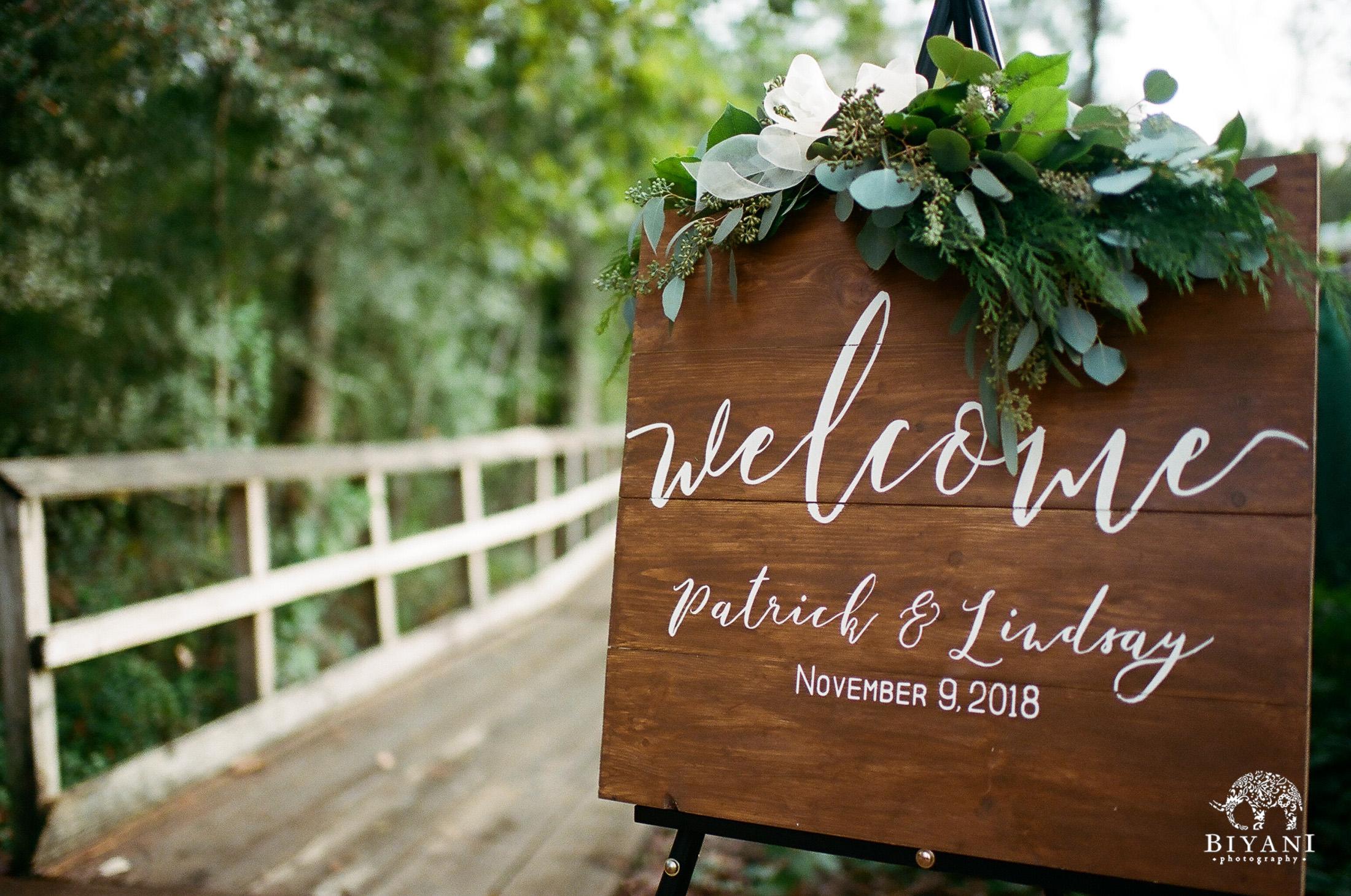 Entrance to forest wedding at Houston Arboretum