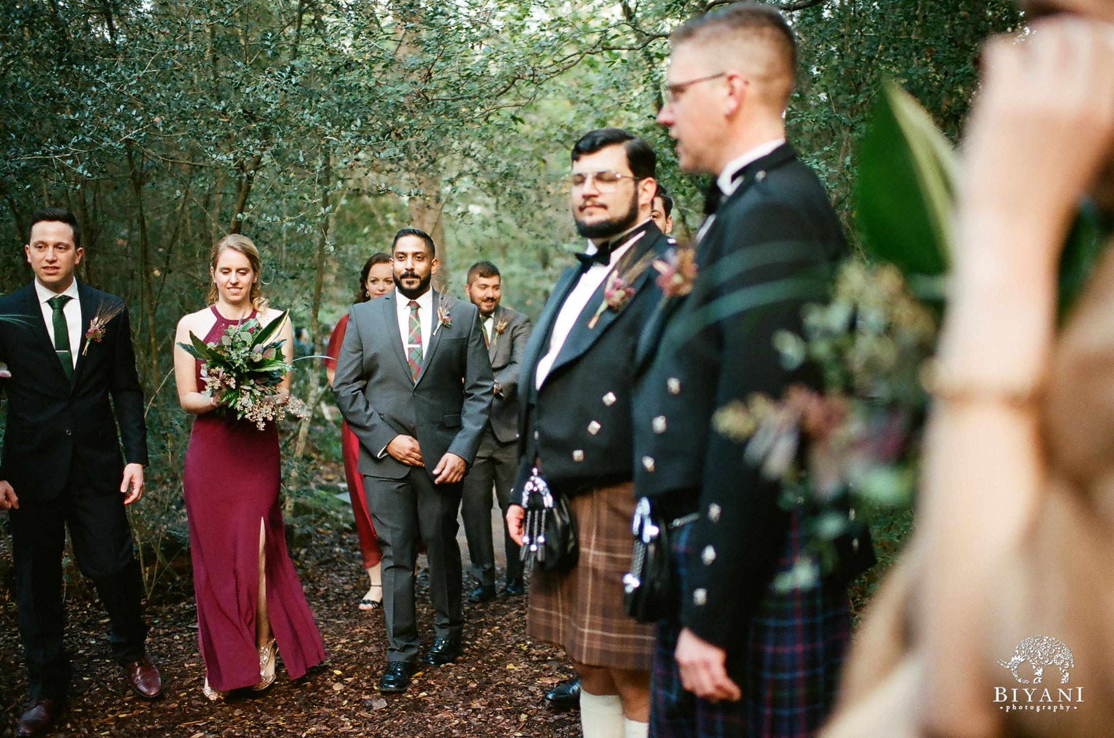 Bridesmaids and groomsmen in the forest