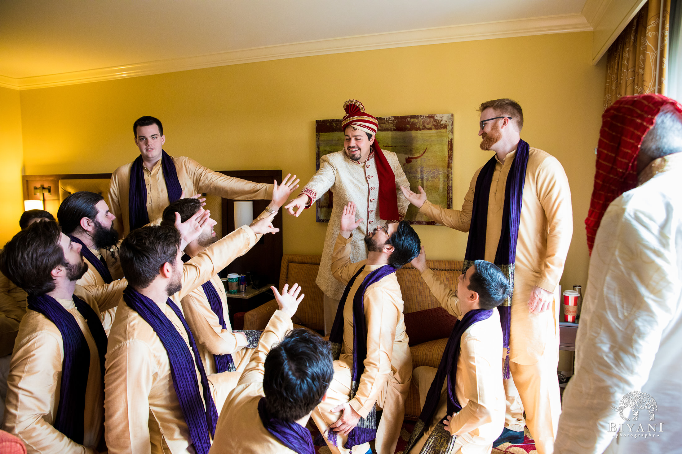 Indian Fusion Groom and groomsmen taking silly photos while getting ready