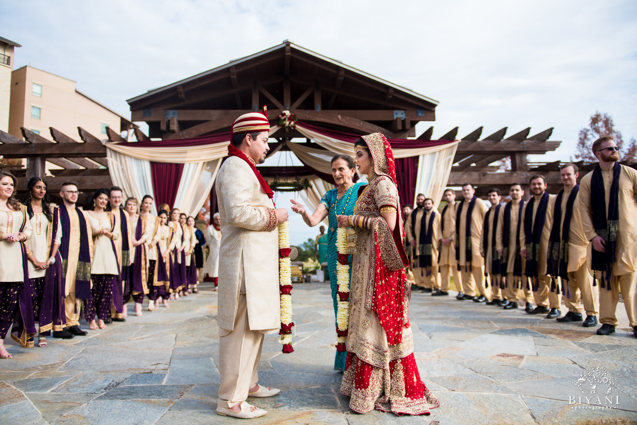 Indian Fusion bride and groom during Indian wedding ceremony outdoors