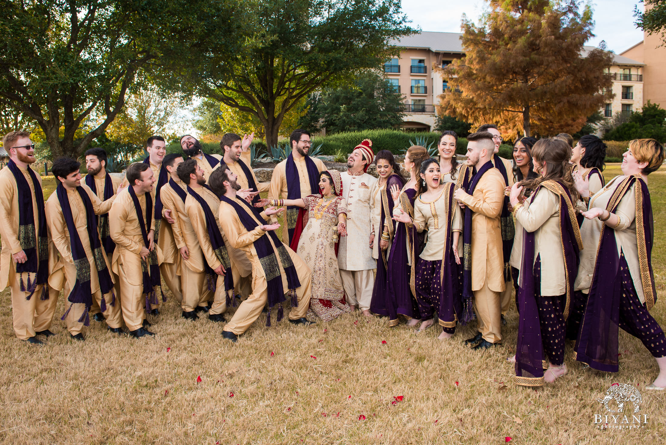 Indian Fusion Wedding Party group photo with bride and groom outdoors