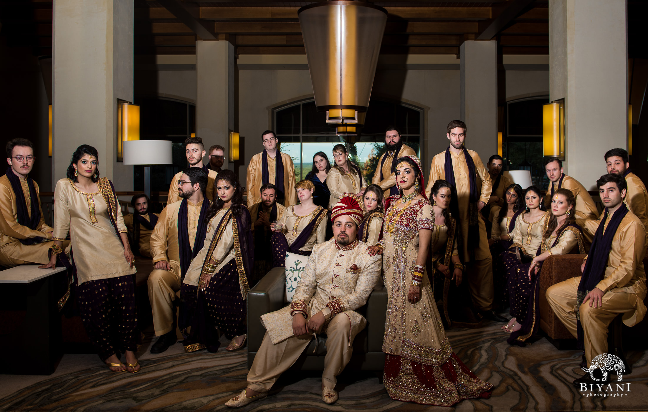 Indian Fusion bridesmaids and groomsmen posing in the hotel lobby with bride and groom