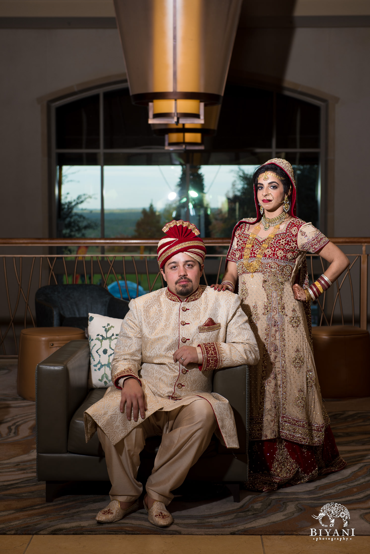 Indian Fusion bride and groom posing in hotel lobby after the wedding ceremony in San Antonio, Tx.