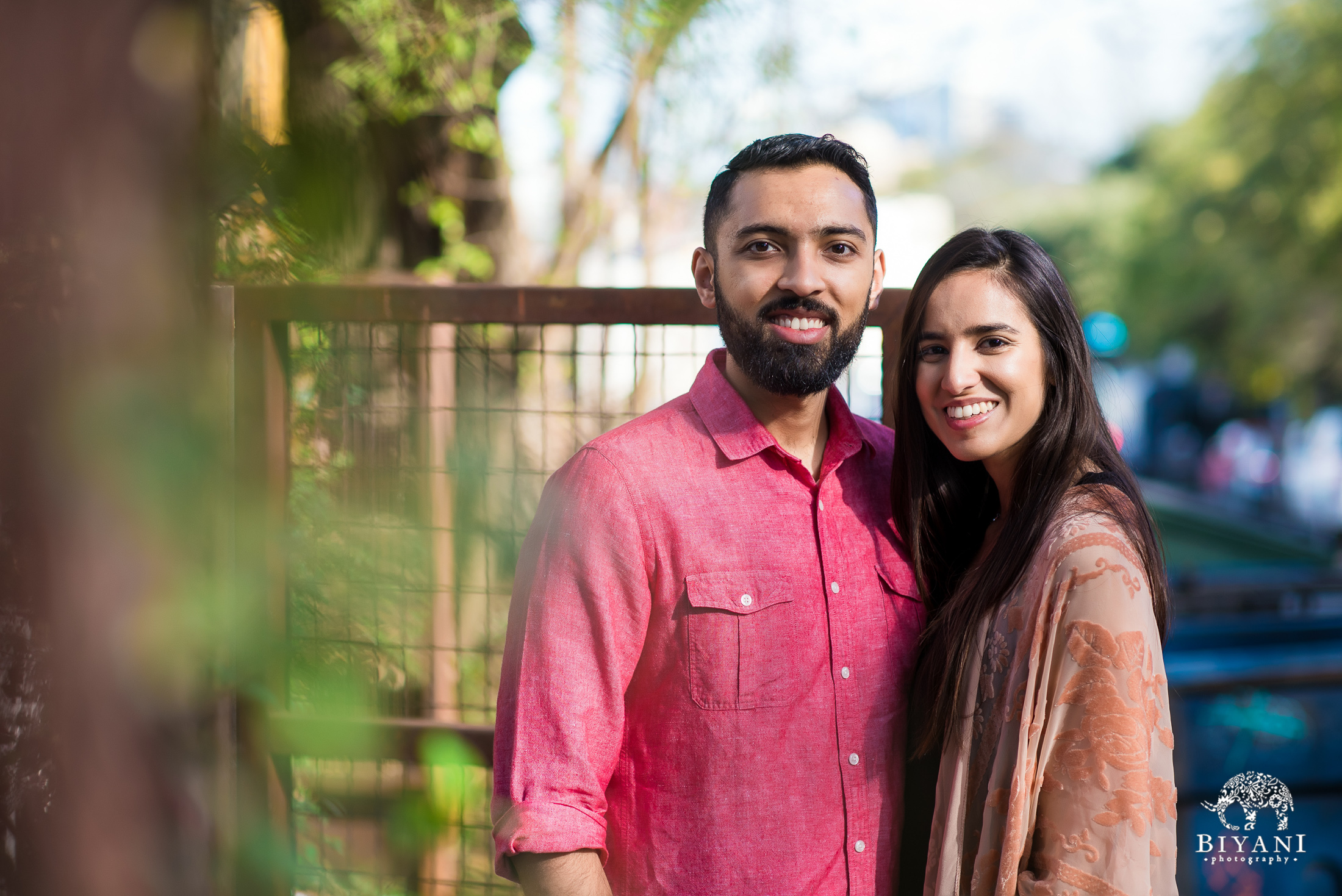 An Indian couple posing on the streets of South Congress Austin, TX for their engagement photo shoot