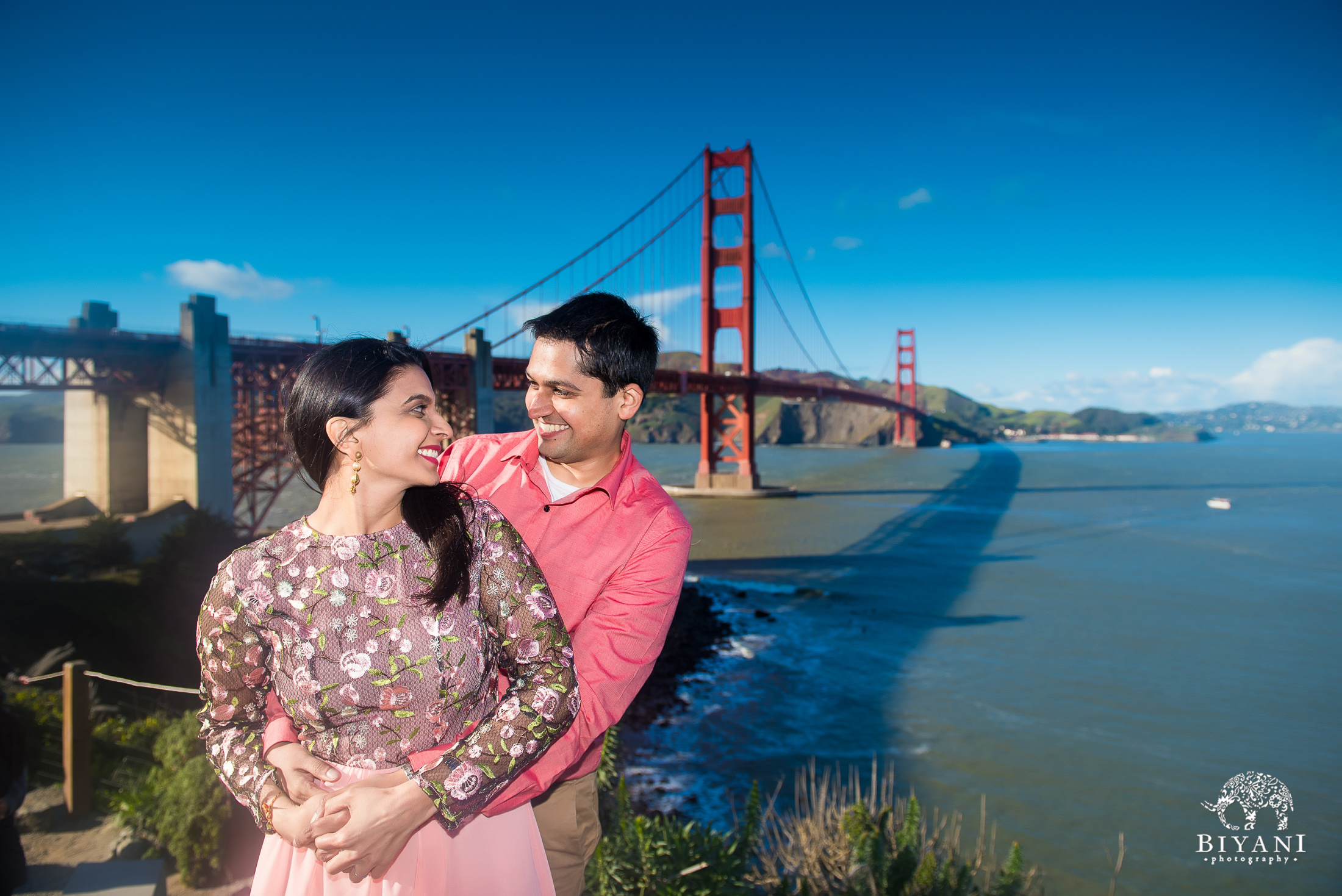 Engagement photo shoot in front of golden gate bridge in San Francisco during the day