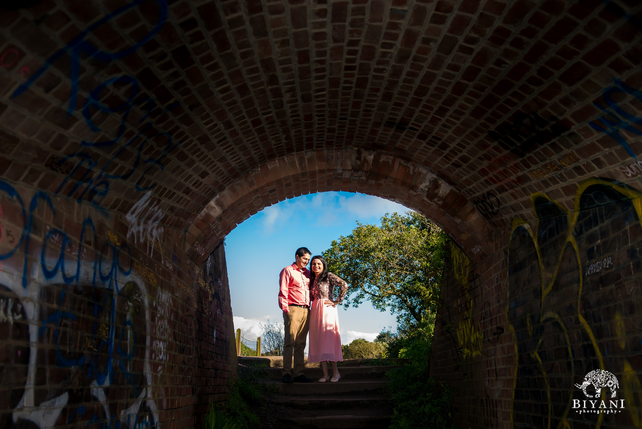 couple posing in a tunnel entrance in San Francisco for engagement photo shoot