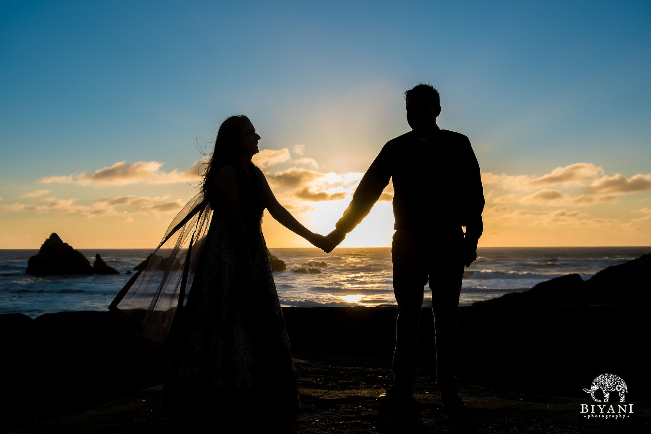 silhouette of couple during sunset on the beach in San Francisco engagement photo shoot