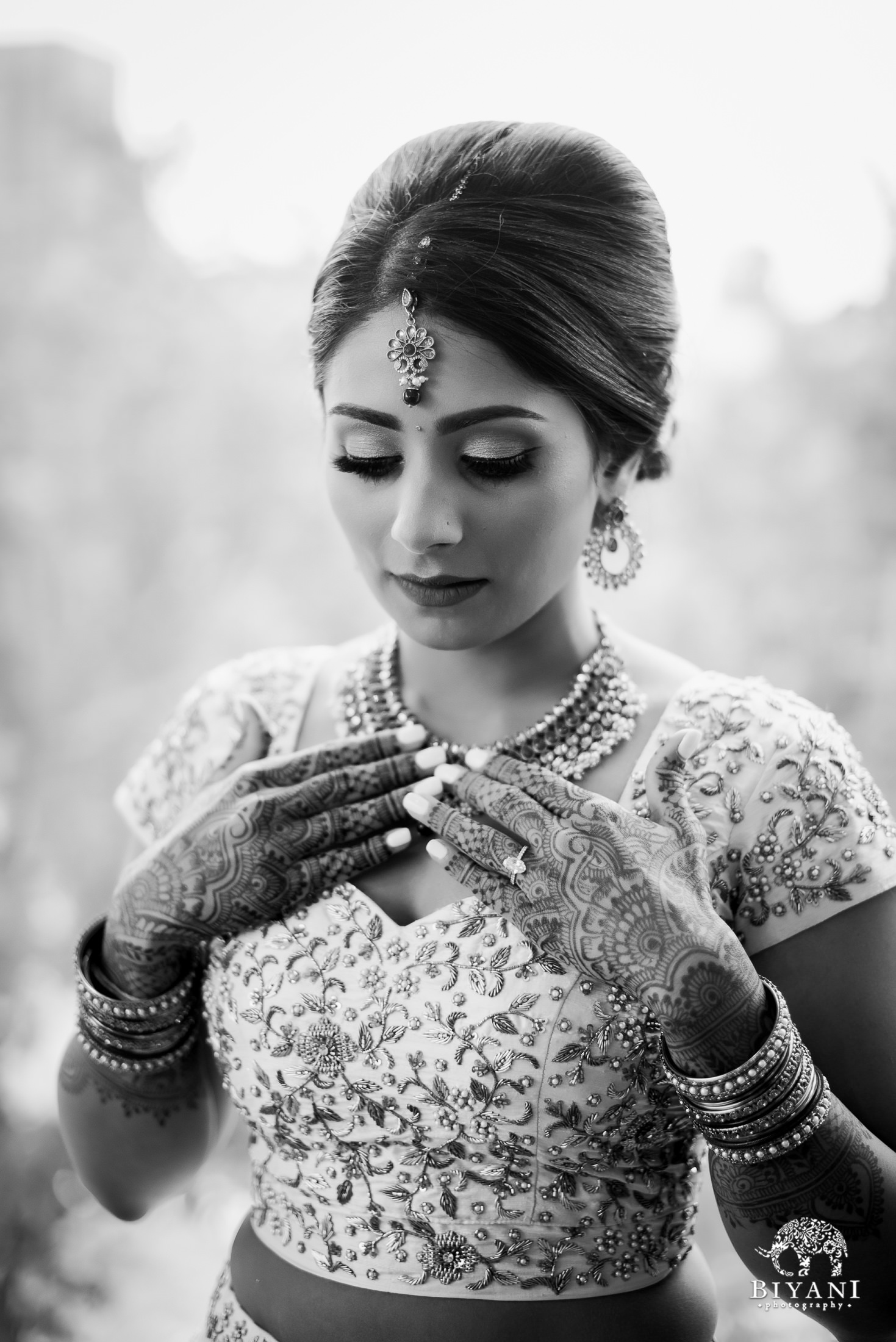 black and white image of bride getting ready on her wedding ceremony day