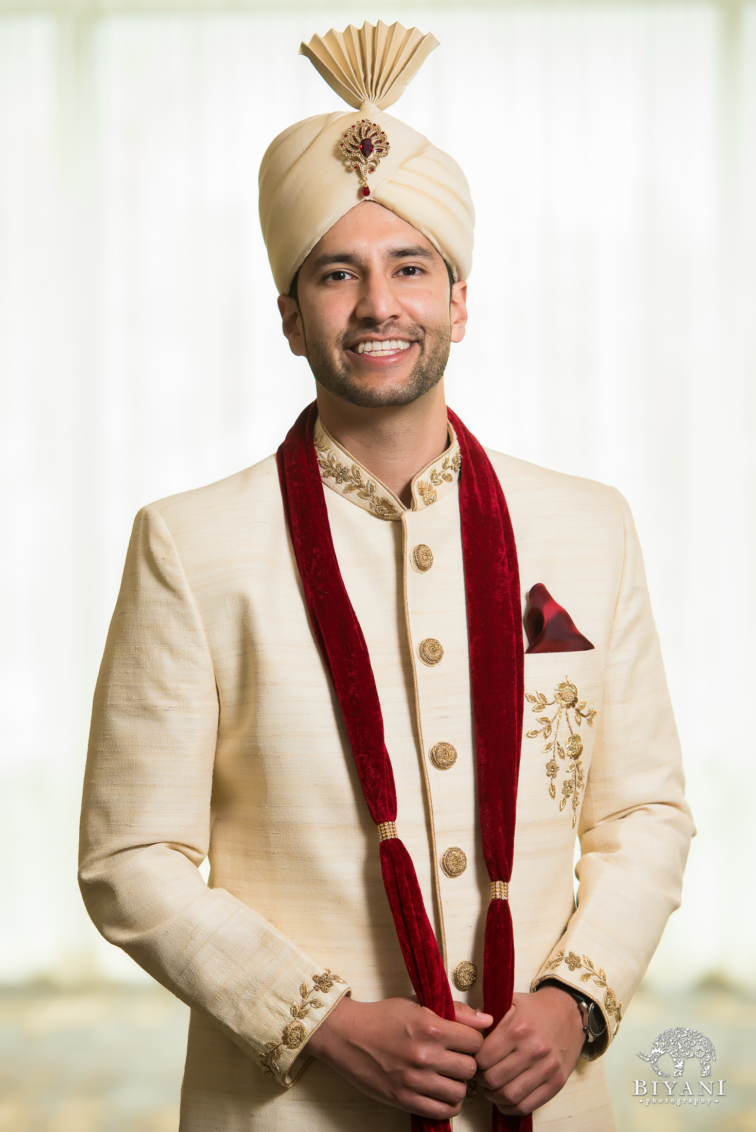 groom portrait dressed in traditional Indian ceremony outfit