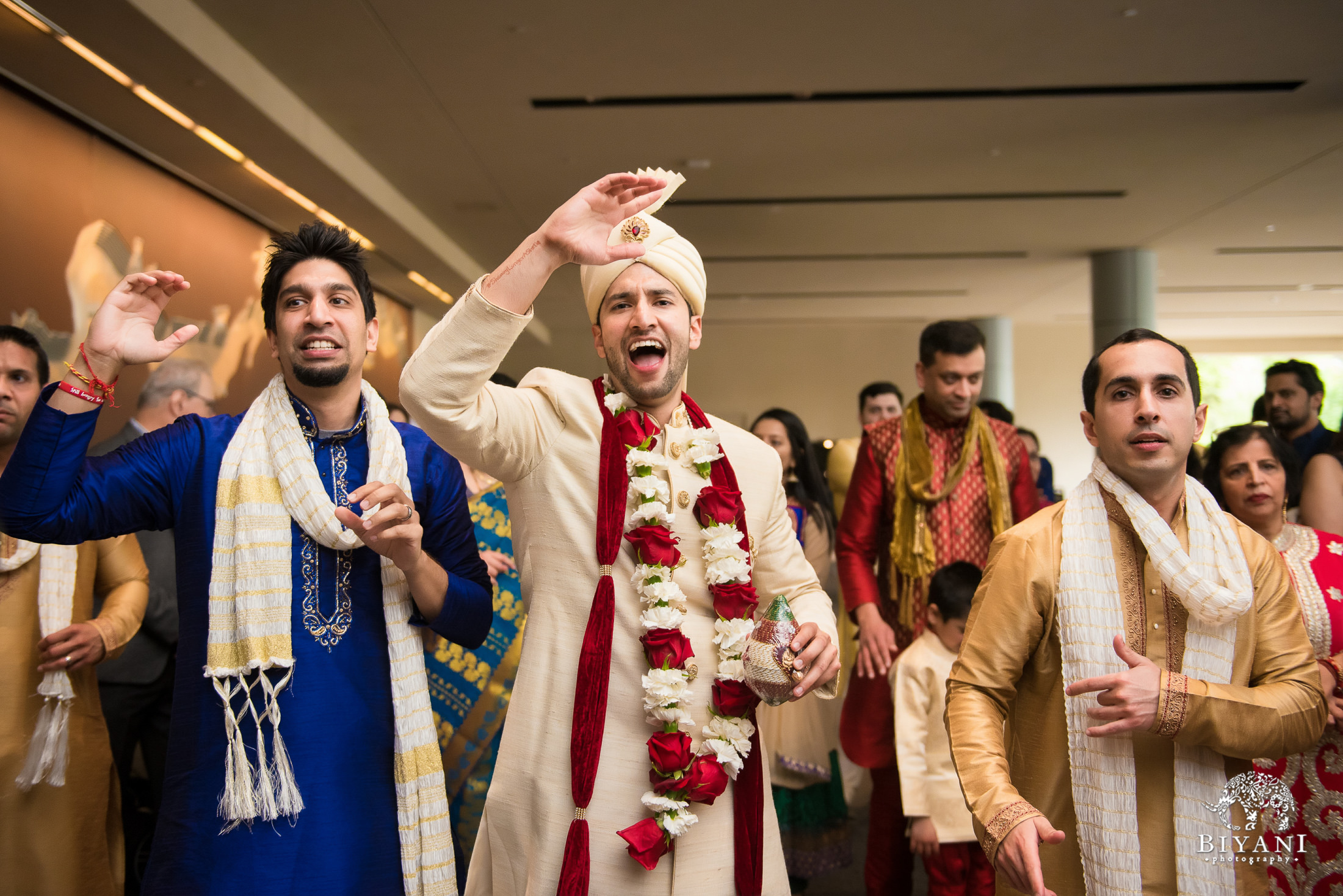 groom dancing during baraat