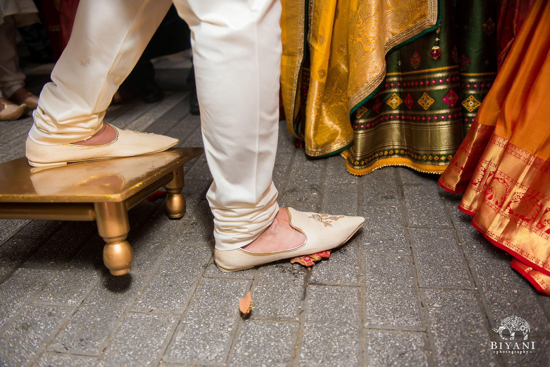 groom smashing the clay pot during baraat ceremony
