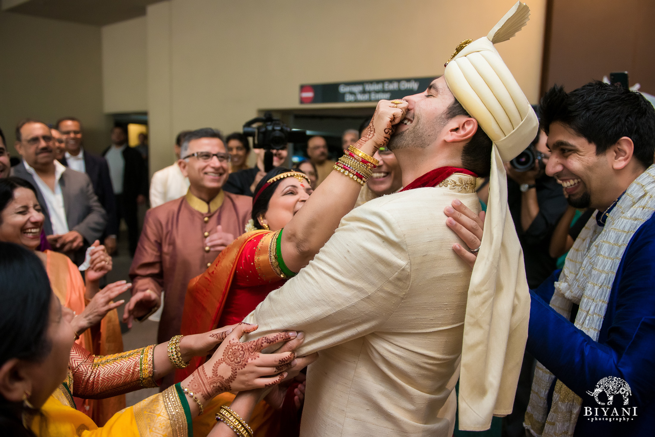 Mother in law grabs groom's nose durin baraat ceremony
