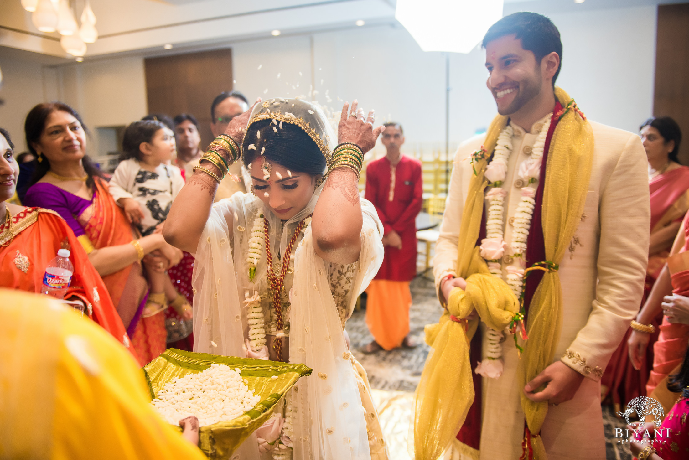 Bride during her vidai throwing rice behind her